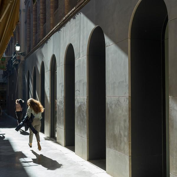 Two women walking in an alley, Granada, Granada Province, Spain