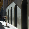 Two women walking in an alley, Granada, Granada Province, Spain