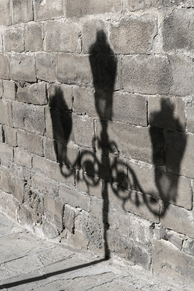 Shadow of lamp post against the stone wall, Ubeda, Jaen Province, Spain