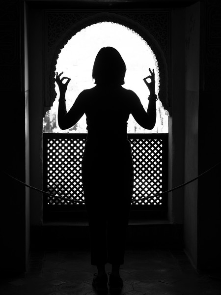 Silhouette of tourist doing mudra sign, Nasrid Palace, Alhambra, Granada, Granada Province, Spain