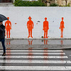 Portrait of a man crossing the road in the rain, Distrito Centro, C�rdoba, C�rdoba Province, Spain
