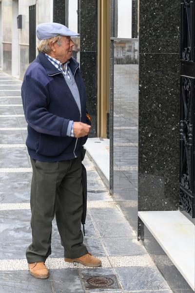 Senior man standing outside a building, Montefr�o, Granada, Granada Province, Spain