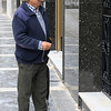 Senior man standing outside a building, Montefr�o, Granada, Granada Province, Spain