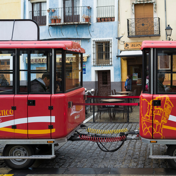 Trailer bus on the street at Plaza Mayor, Cuenca, Spain
