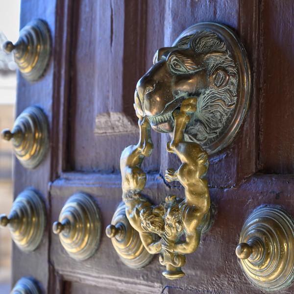 Close-up of brass door knocker, �beda, Jaen Province, Spain