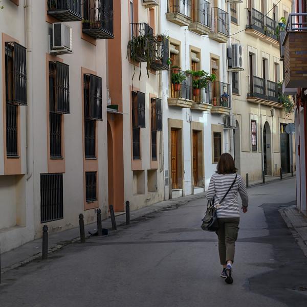 Rear view of woman walking on the street, �beda, Jaen Province, Spain