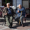 Old male friends sitting on bench, Plaza Del Socorro, Ronda, Malaga, Andalusia, Spain