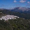 Aerial view of houses in a town, El Mirador Del Genal, Malaga Province, Spain