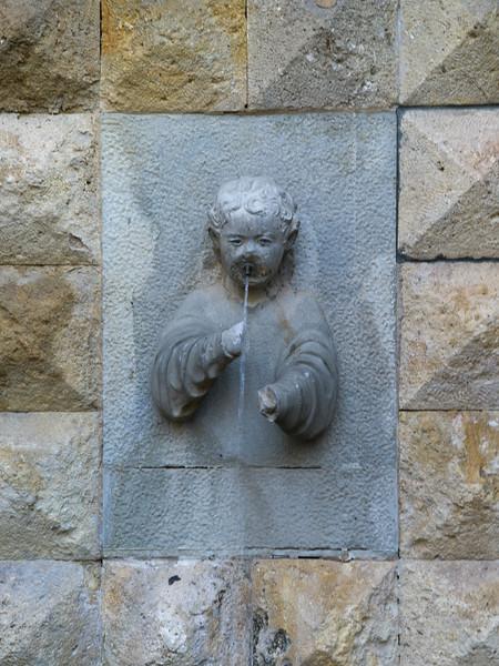 Fountain against historic wall, Cordoba, Andalusia, Spain