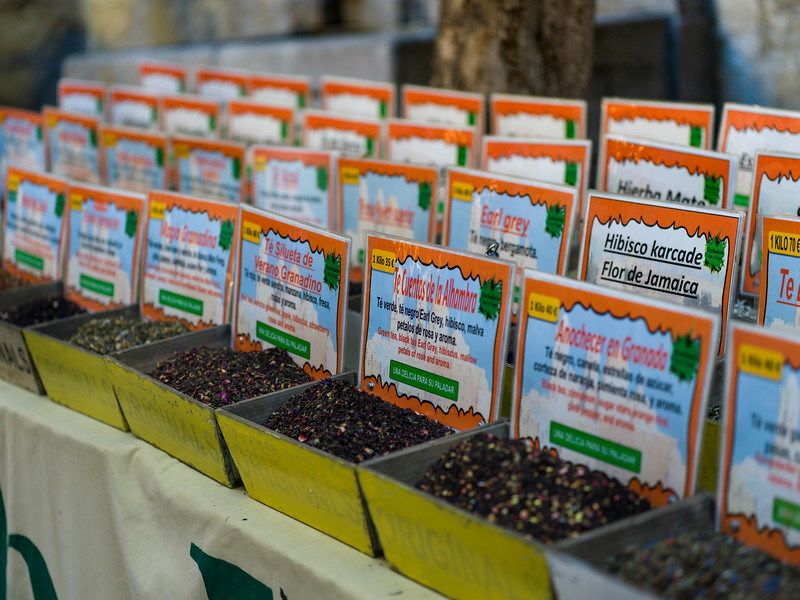 Row of spices displayed in market at Granada, Granada Province, Spain