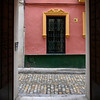 Open doorway of a house, Seville, Seville Province, Spain