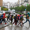 School children crossing the road in rainy season, Town of Carmona, Carmona, Seville Province, Spain