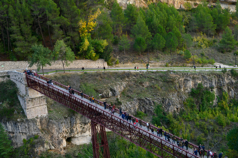 Tourists walking on a bridge, Saint Paul Bridge, Barrio De Tiradores, Cuenca, Cuenca Province, Castilla La Mancha, Spain