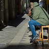 Man relaxing on stool, Granada, Granada Province, Spain