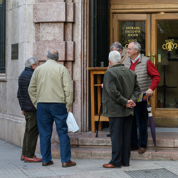 Senior male friends having leisure time on street corner, Antequera, Andalusia, Spain