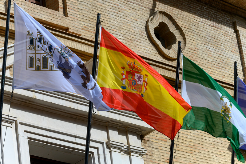 Low angle view of flags, Antequera, M�laga, Spain
