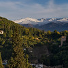 View of town with snowcapped mountain in the background, Granada, Spain