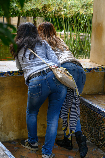 Two female friends at Alcazar Palace, Plaza De Espana, Seville, Seville Province, Spain