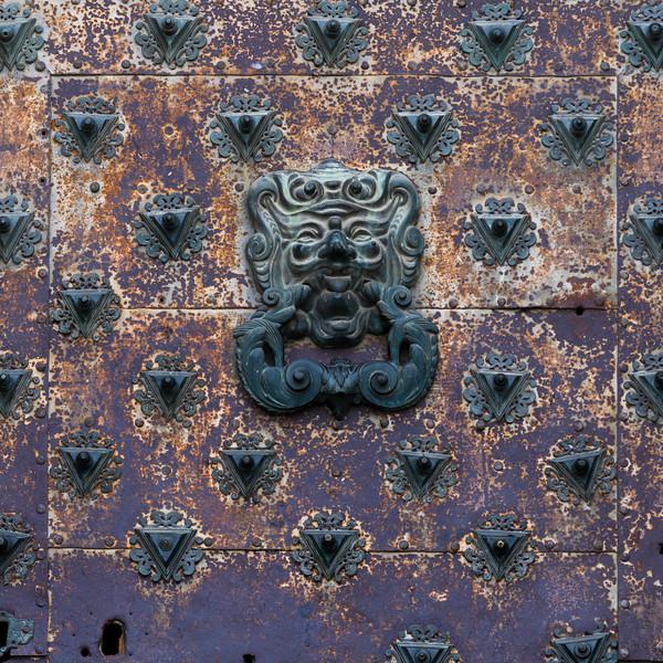 Rusted door knocker against church wall, Cuenca Cathedral, Cuenca, Cuenca Province, Castilla La Mancha, Spain