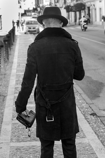 Rear view of man standing on the street, Ronda, Malaga, Andalusia, Spain