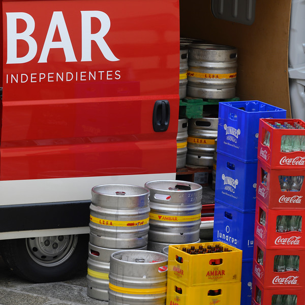 Pick up truck loading empty beer kegs and coke bottle crates for recycling, Cuenca, Cuenca Province, Castilla La Mancha, Spain