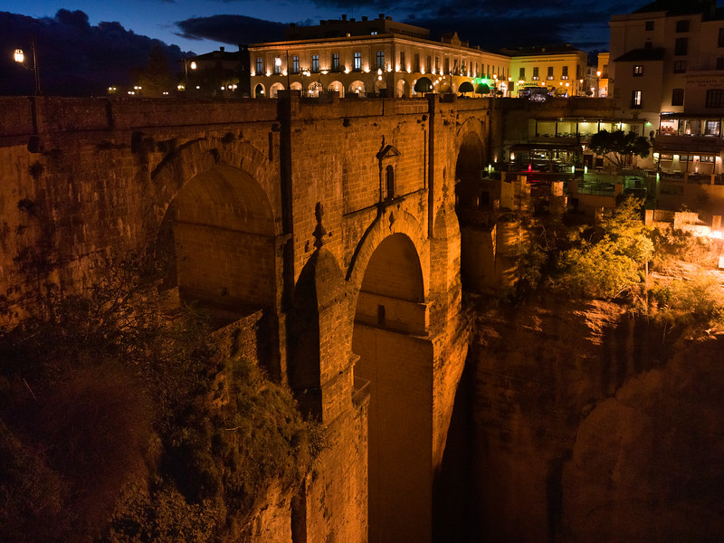 Illuminated city on top of Puente Nuevo Bridge, Ronda, Malaga Province, Spain