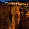Illuminated city on top of Puente Nuevo Bridge, Ronda, Malaga Province, Spain