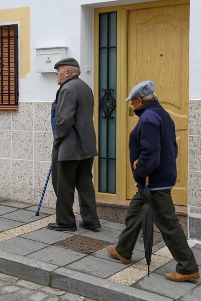 Two seniors men walking on footpath, Montefr�o, Granada, Granada Province, Spain