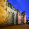 Ruins of the historic wall Torre De Calahorra against twilight sky at night, Cordoba, Andalusia, Spain