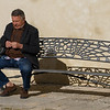 Senior man sitting on bench, Ronda, Malaga, Andalusia, Spain