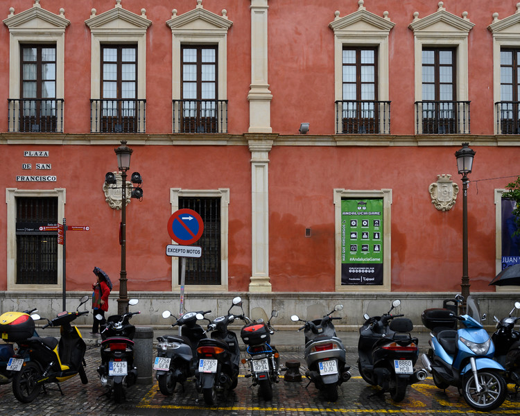Motorcycles parked on the street, Seville, Seville Province, Spain