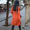 Rear view of fashionable woman walking down the street, Santa Cruz, Seville, Seville Province, Spain
