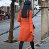 Rear view of fashionable woman walking down the street, Santa Cruz, Seville, Seville Province, Spain
