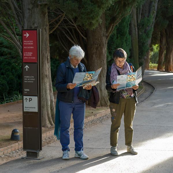 Senior couple reading road map, Granada, Granada Province, Spain