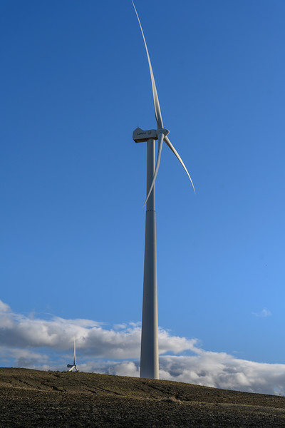 Wind turbines on hill against blue sky, Spain
