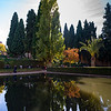 Tourist seen near by the pond at Nasrid Palaces, Alhambra, Granada, Spain