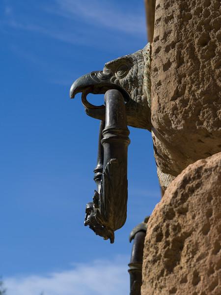 Gargoyle door knocker against stone wall, Alhambra Palace, Alhambra, Granada, Spain