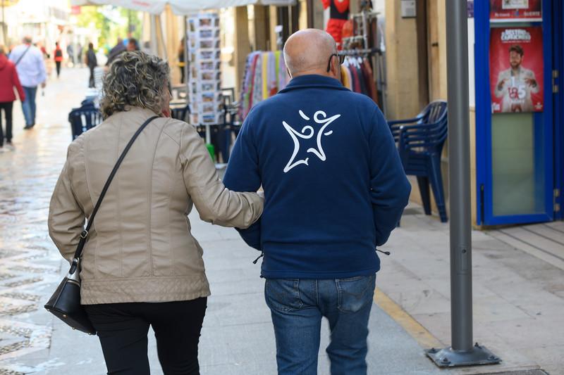 Senior couple walking on the street, Ronda, Malaga, Andalusia, Spain
