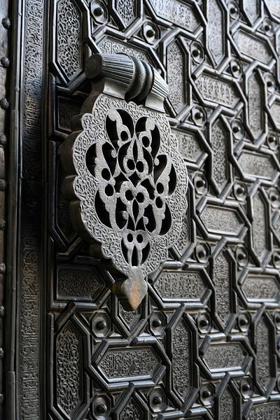 Details of carvings made on metallic door, Santa Cruz, Seville, Seville Province, Spain