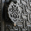 Details of carvings made on metallic door, Santa Cruz, Seville, Seville Province, Spain