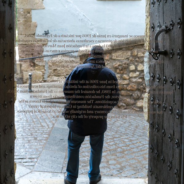 Rare view of man standing at the Entrance of the Spanish Abstract Art Museum, Cuenca, Spain