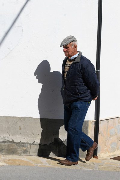 Senior man walking on the street, Algatocin, Malaga, Andalusia, Spain