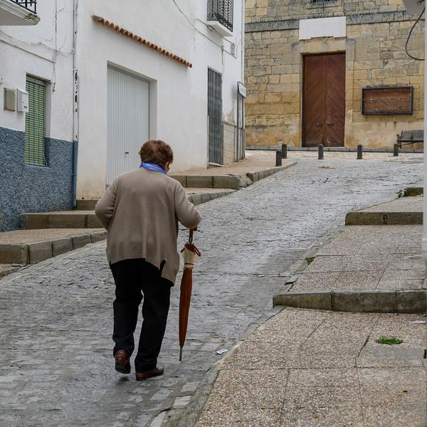 Elderly woman walking on the street, Montefr�o, Granada, Granada Province, Spain