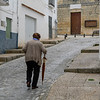 Elderly woman walking on the street, Montefr�o, Granada, Granada Province, Spain