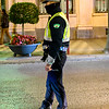 Traffic officer standing in the middle of the street at night, Albolote, Granada Province, Spain