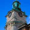 Low angle view of clock tower of Catholic cathedral, Storkyrkan, Gamla Stan, Sweden