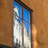 Reflection of building on glass window, Gamla Stan, Stockholm, Sweden