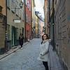 Woman standing in street, Gamla Stan, Stockholm, Sweden