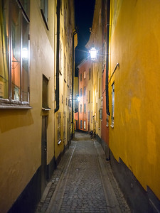 View of narrow street at night, Stockholm, Sweden