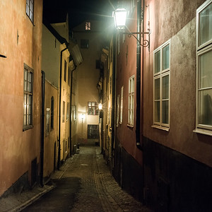 View of narrow alley at night, Stockholm, Sweden